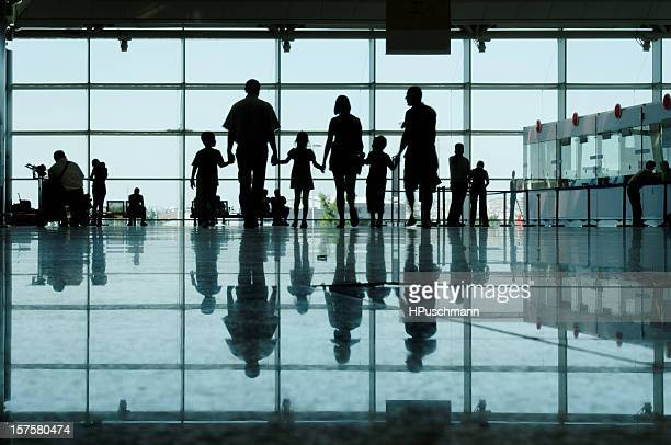 Large family on an airport concourse