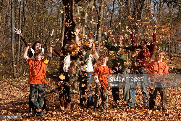 Large Family Playing in the Autumn Leaves