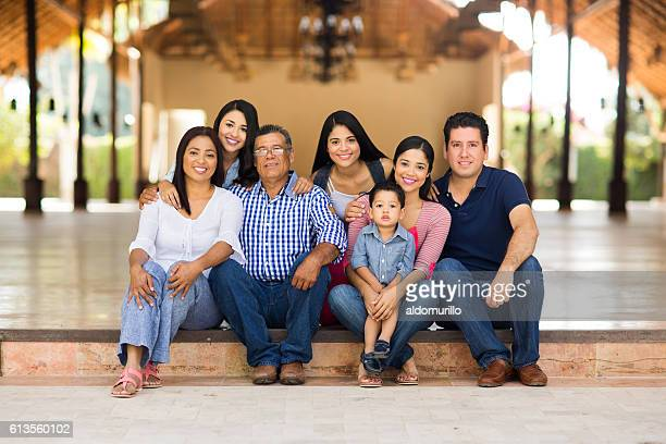 Large family sitting and smiling at the camera