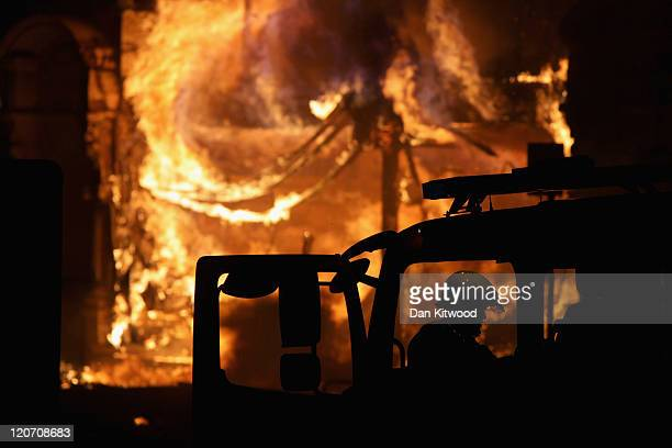 A large fire breaks out in shops and residential properties in Croydon on August 8 2011 in London England Sporadic looting and clashes with police...