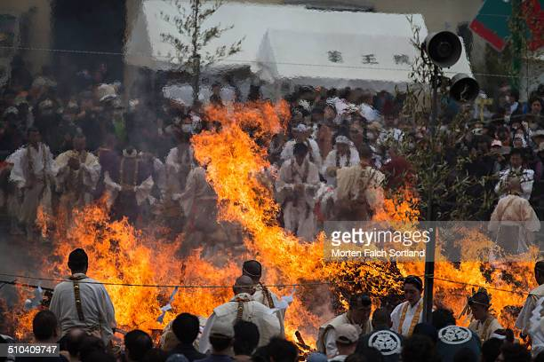 A large fire burning at a festival at a temple in Hachôji close to Tokyo When the fire is smaller the monks will walk over it on bare feet