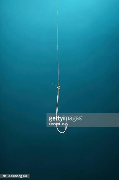 Large fishing hook on blue background