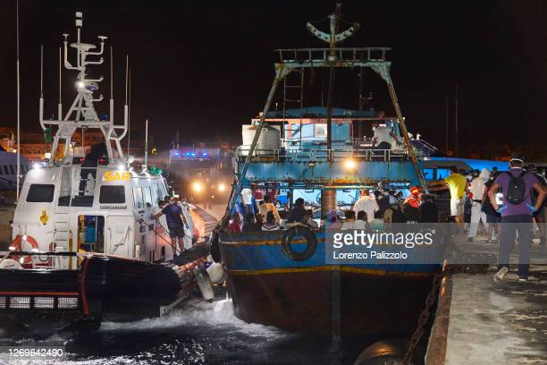 Large fishing ship coming from Libya and just arrived in port in the night escorted by the Italian Coast Guard, is about to disembark 450 migrants...