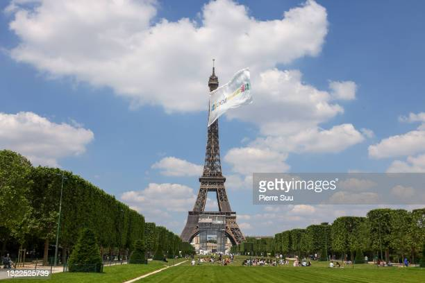 Large flag is displayed atop the Eiffel tower as part of some test for the usage of drones during the 2024 Paris Olympic games. At Eiffel Tower on...