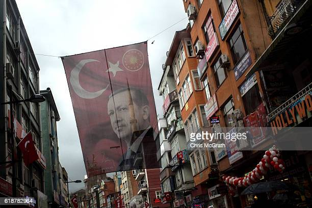 A large flag of Turkish president Recep Tayyip Erdogan is seen hanging over a main street on October 25 2016 in Rize Turkey Although born in...