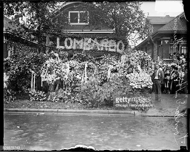 Large floral sign wreaths and floral arrangements in front of the home of reputed gangster Tony Lombardo in Chicago Illinois during Lombardo's...