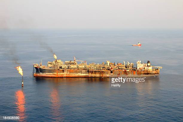 large fpso oil rig - flare stack stock photos and pictures