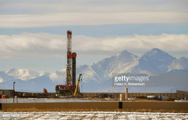A large fracking operation becomes a new part of the horizon with Mount Meeker and Longs Peak looming in the background on December 28 2017 in...
