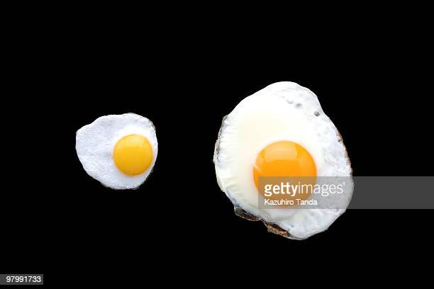 large fried egg and small fried egg