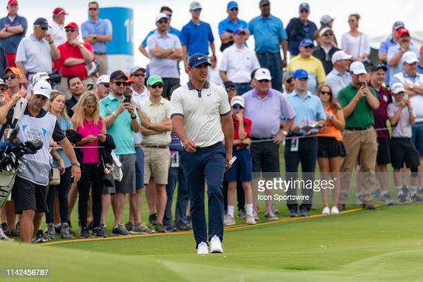 A large gallery follows Brooks Koepka to the ninth green during the first round of the ATT Byron Nelson on May 9 2019 at Trinity Forest Golf Club in...