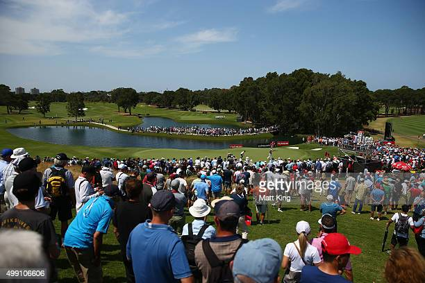 A large gallery follows the final group of Matt Jones of Australia and Jordan Spieth of the United States on the 9th green during day four of the...