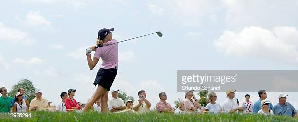 A large gallery watches as Dakoda Dowd hits her tee shot during the first round of the Ginn Open in Reunion Florida Thursday April 27 2006 Dakoda's...