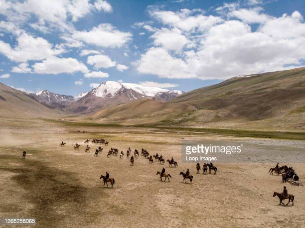 Large game of Buzkashi in a remote Kyrgyz settlement in the Wakhan Corridor of Afghanistan.