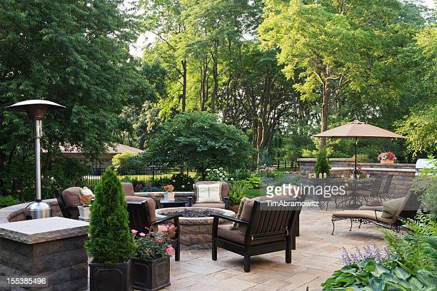 large garden patio - fire pit stock pictures, royalty-free photos & images