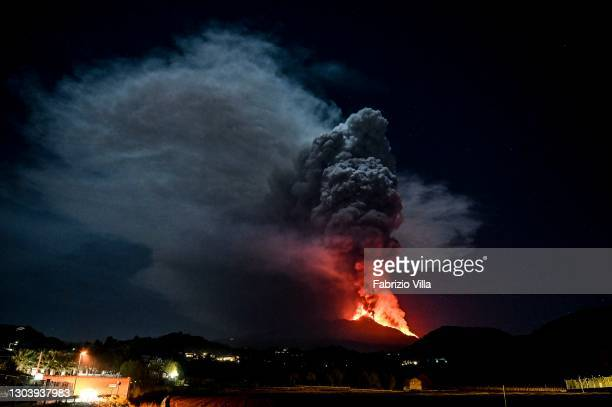 Large gas cloud, seen from Trecastagni, erupts from Mount Etna, which has been spewing lava, ash and volcanic rock toward the Bove Valley for more...