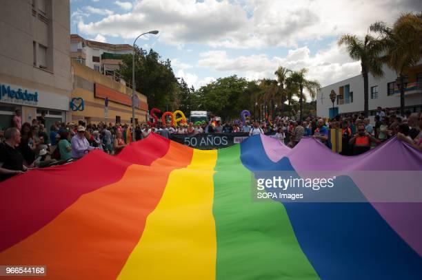 A large gay pride flag is waved by people as they take part in the Pride LGTB Torremolinos 2018 Torremolinos celebrates this week the LGBT Pride 2018...