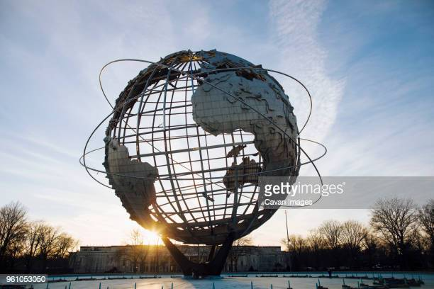 large globe against sky at flushing meadows corona park - flushing queens stock pictures, royalty-free photos & images