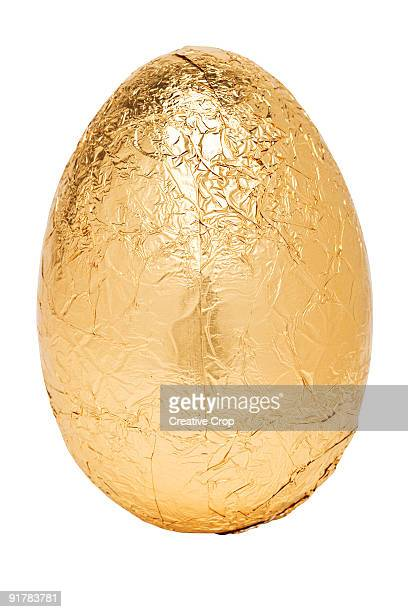 large gold easter egg - easter egg stock pictures, royalty-free photos & images