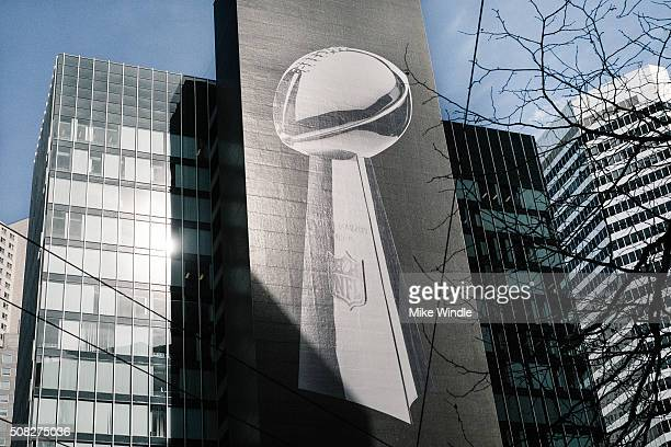 A large graphic of the Vince Lombardi Trophy promoting Super Bowl 50 is displayed on a skyscraper on February 3 2016 in San Francisco California