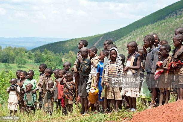 large group of african children in a field, burundi - burundi east africa stock pictures, royalty-free photos & images
