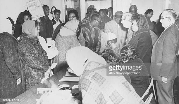 A large group of AfricanAmerican voters registers to vote in advance of an election Baltimore Maryland March 21 1964