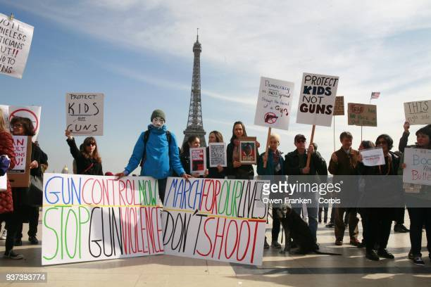 Large group of Americans and French hold a March for Our Lives anti-NRA anti-gun rally on Place de Trocadero, facing the Eiffel Tower, on March 24,...