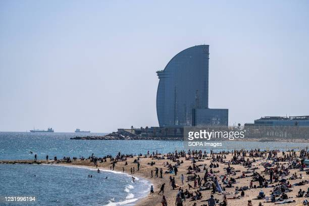 Large group of bathers are seen on Barceloneta beach. Barcelona kicks off the new 2021 beach season with new security devices such as the new...