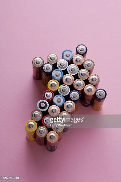A large group of batteries arranged into the shape of an arrow, pointing up