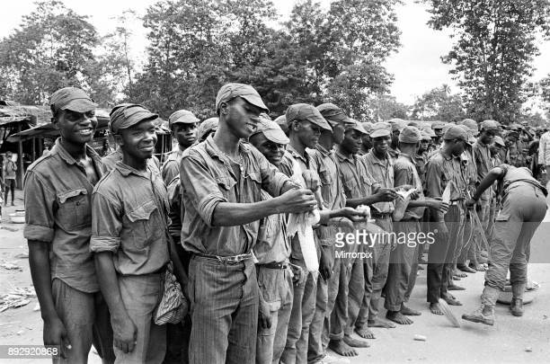 A large group of Biafran soldier seen here during the conlifct some taking a break for some food 11th June 1968
