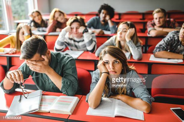 large group of bored students at lecture hall. - boredom stock pictures, royalty-free photos & images