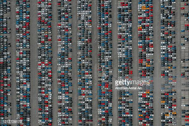 large group of brand new vehicles as seen from above, netherlands - middelburg netherlands stock pictures, royalty-free photos & images