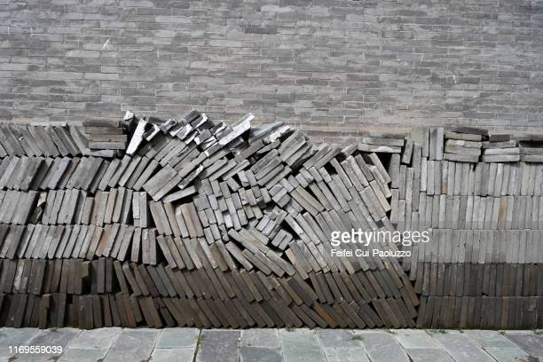 large group of brick in front of a brick wall - hohhot stock pictures, royalty-free photos & images