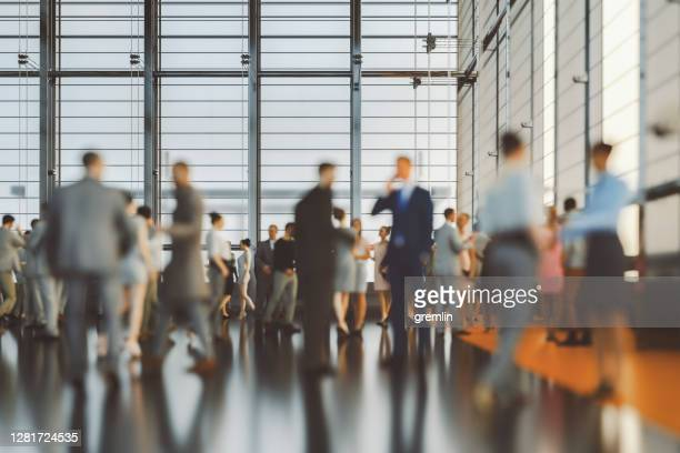 large group of business people in convention centre - conference centre stock pictures, royalty-free photos & images