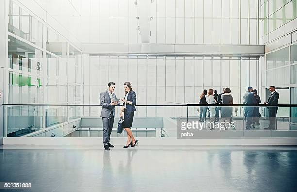 large group of business people in lobby - hotel lobby stock pictures, royalty-free photos & images