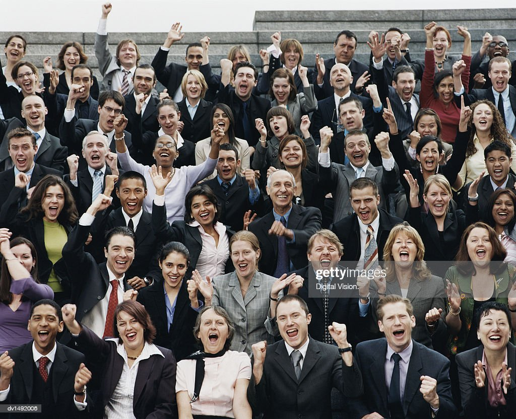 Large Group of Business People Sitting Outdoors and Cheering : Stock Photo