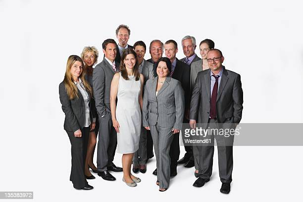 Large group of business people standing against white background
