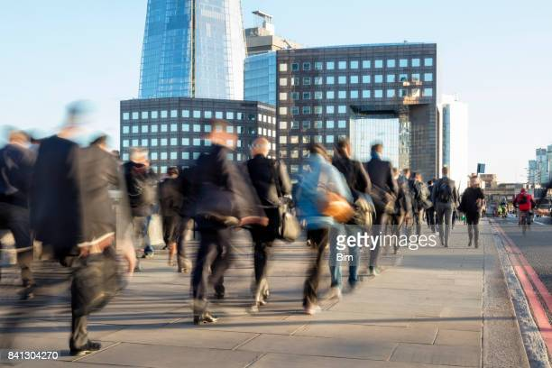 Large Group of Businesspeople Walking in London Financial District, Blurred Motion