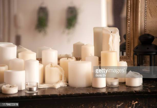 large group of candles on fireplace - candle stock pictures, royalty-free photos & images