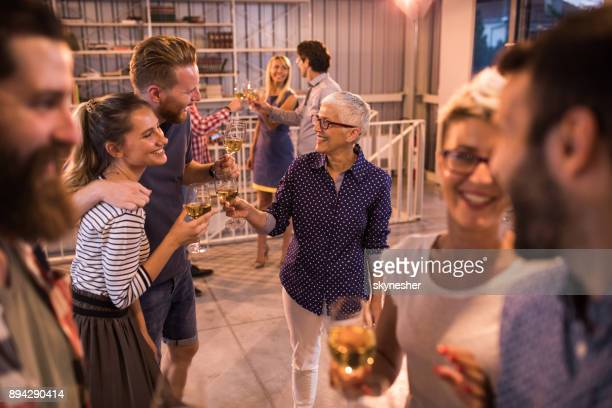 large group of casual business people having fun at office party. - work party stock pictures, royalty-free photos & images
