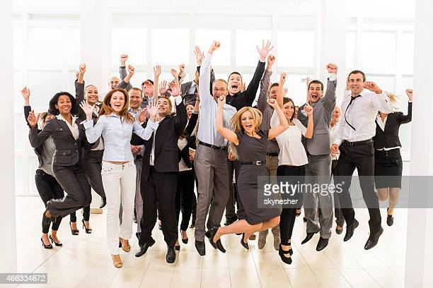 Large group of cheerful business people jumping.