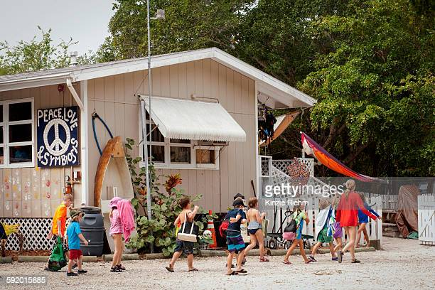Large group of children and teacher returning to sea school, Sanibel Island, Pine Island Sound, Florida, USA