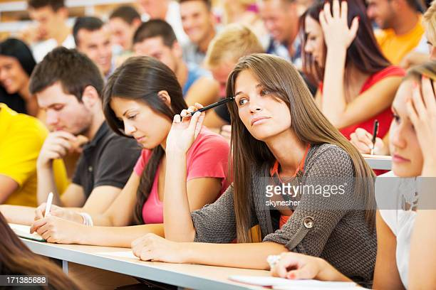 Large group of college students at lecture hall.