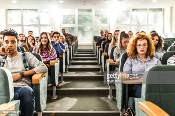 large group of college students in a lecture hall. - auditorium stock pictures, royalty-free photos & images