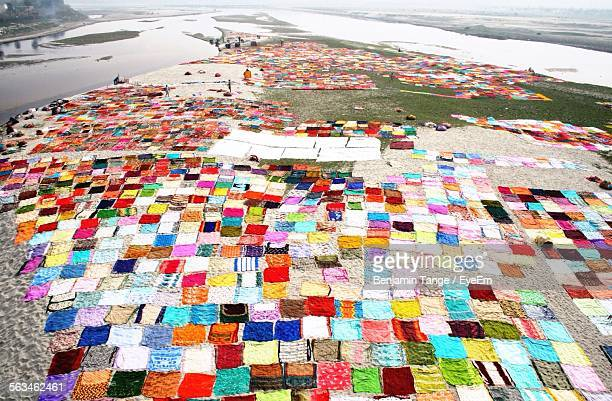Large Group Of Colorful Clothes Drying By The Lake