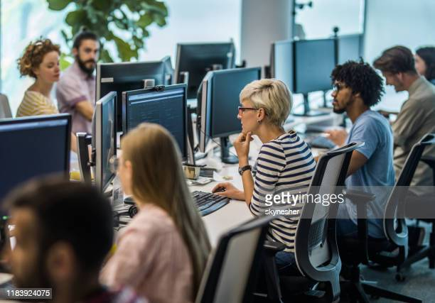 large group of computer programmers working in the office. - large group of people stock pictures, royalty-free photos & images
