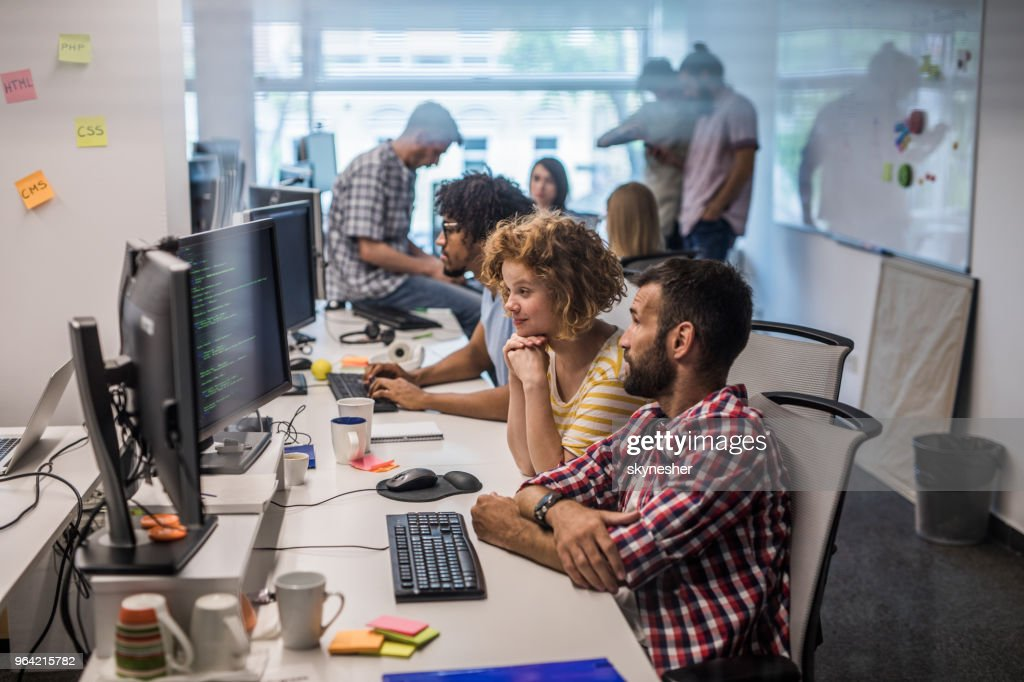 Large group of computer programmers working in the office. : Stock Photo