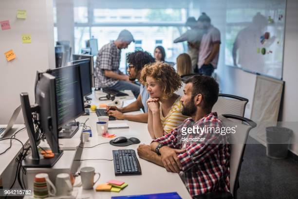 large group of computer programmers working in the office. - coding stock pictures, royalty-free photos & images