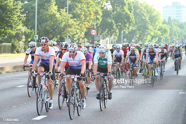 Large group of cyclists taking part in RideLondon, 4th August 2013. Riding westbound on the A4 in Chiswick west London.