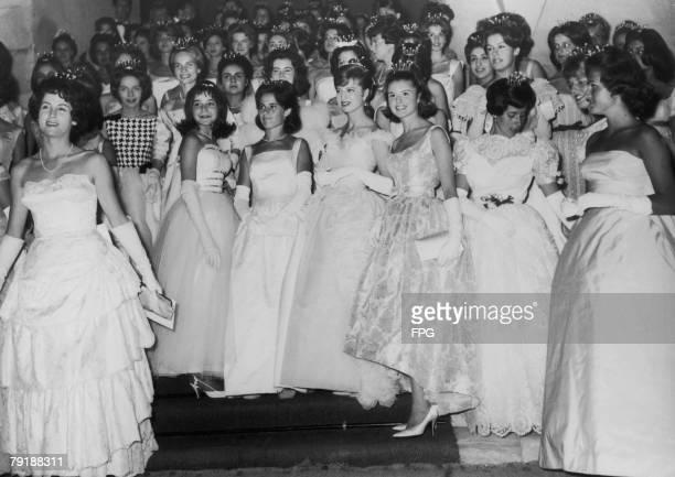 A large group of debutantes in tiaras circa 1955
