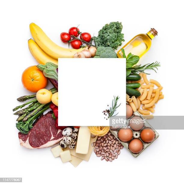 large group of different kind of food shot from above with copy space - food pyramid stock pictures, royalty-free photos & images